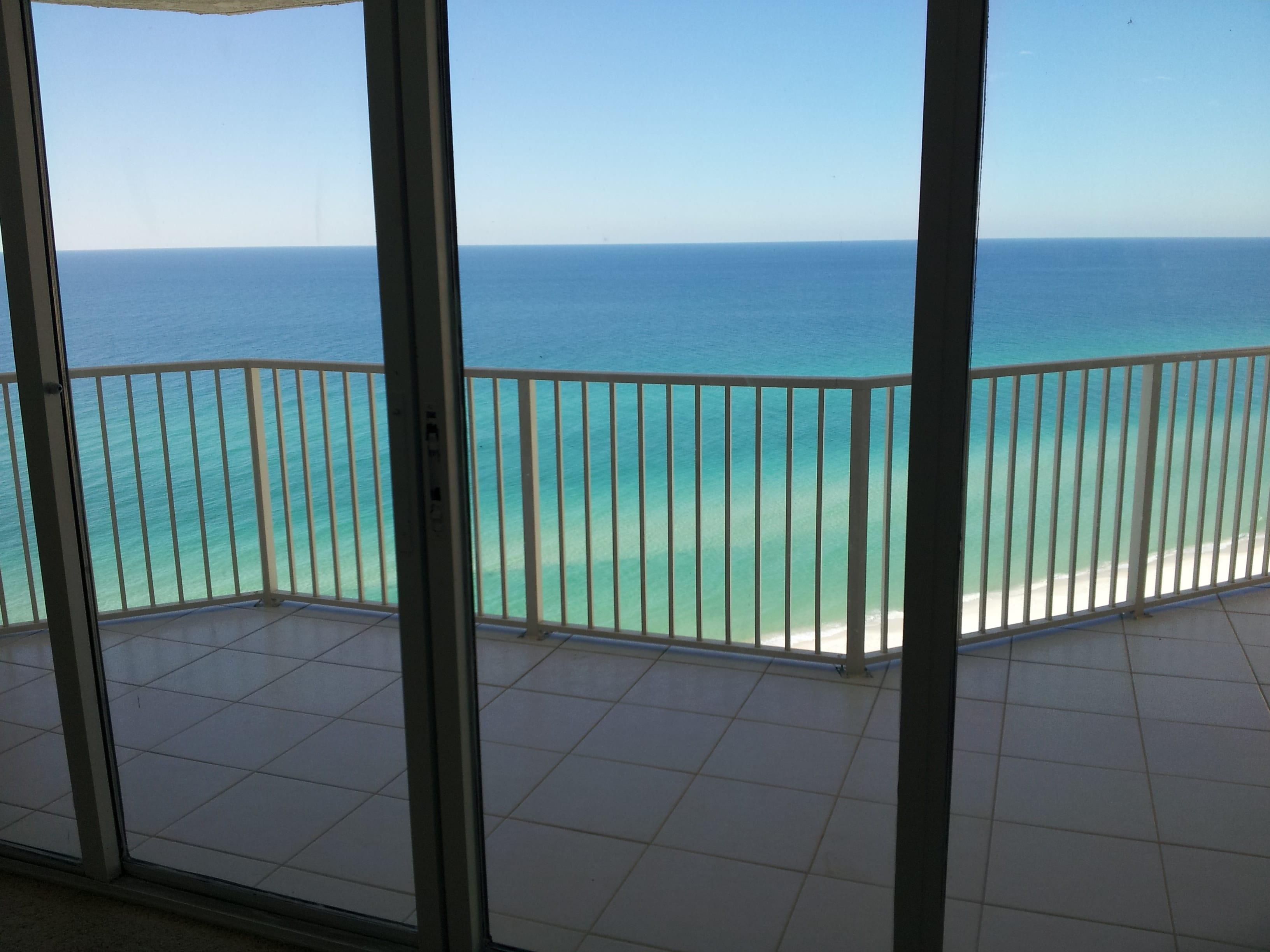 view of balcony and panama city beach from dunes of panama tower e condominium unit