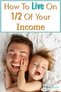 how to live on half of your income above dad and daughter laying on bed smiling