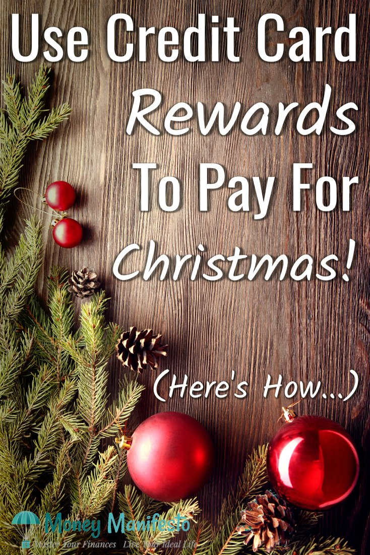 use credit card rewards to pay for Christmas here's how above pine tree cuttings and two red ball ornaments