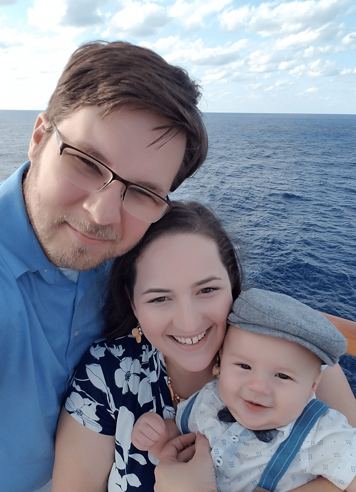 Lance and Victoria Cothern and their son on a cruise
