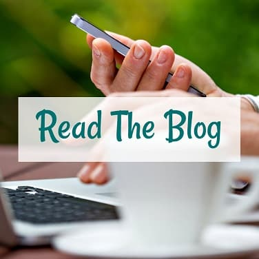 read the blog overlayed over hands holding a cell phone and typing on a laptop with a coffee mug in the foreground