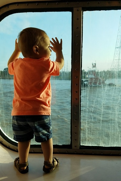 1 year old standing in oceanview stateroom window on carnival dream cruise ship