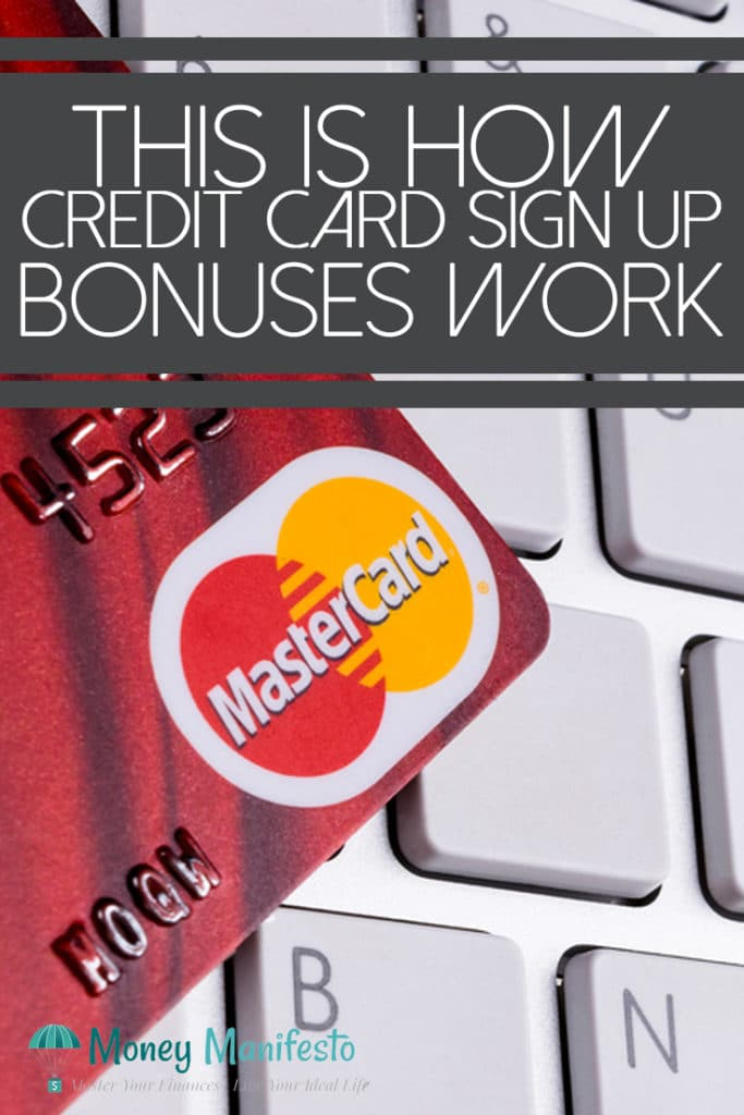 this is how credit card sign up bonuses work above red mastercard credit card on white keyboard