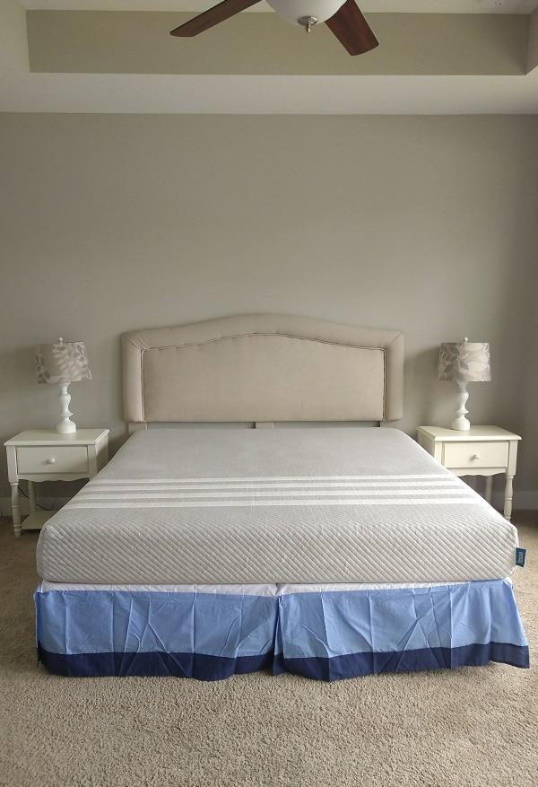 king size leesa mattress on box springs with beige headboard and two night stands